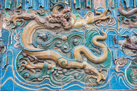 Yellow dragon on the nine dragon wall in the old town of Pingyao 스톡 콘텐츠