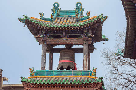 Looking up at the bell tower in the City God Temple in the old town of Pingyao