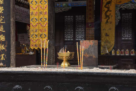 Burning incense in the City God Temple in the old town of Pingyao