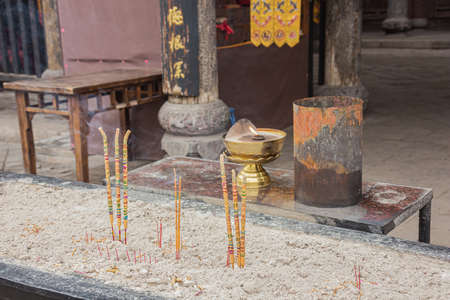 Close up of incense sticks in the City God Temple in the old town of Pingyao