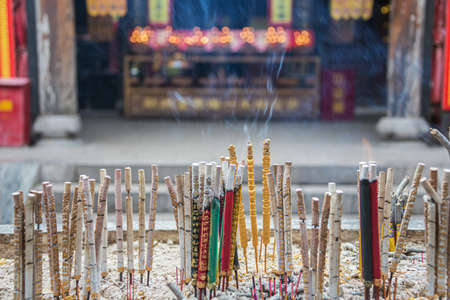 Close up of smoking incense sticks in the City God Temple in the old town of Pingyao 스톡 콘텐츠