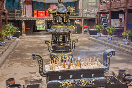Censer in the courtyard of the City God Temple in the old town of Pingyao