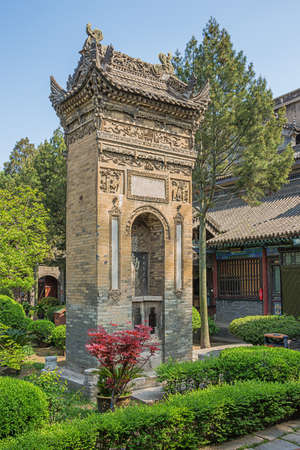Decorated ornamental gate in the garden of the Great Mosque in Xian