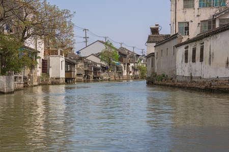 Navigating on Shantang Canal between ancient houses 스톡 콘텐츠