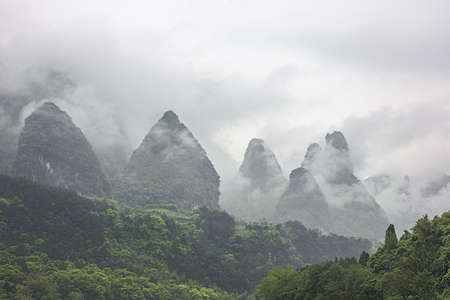 Heavy clouds covering the hills bordering the Li River in the vicinity of Yangshuo near Guilin