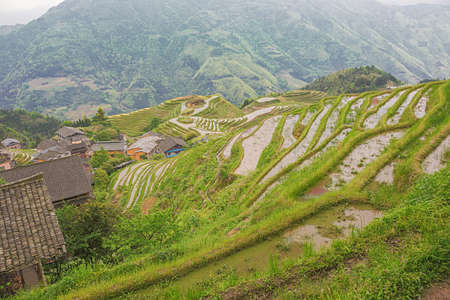 Looking down over rice terraces of Pingancun in the Longsheng area near Guilin Stock fotó