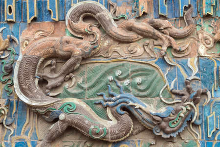 Brown and blue dragon on the nine dragon wall in the old town of Pingyao