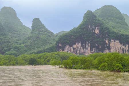 Flooded river banks near the Mopanshan wharf navigating on the Li River near Guilin