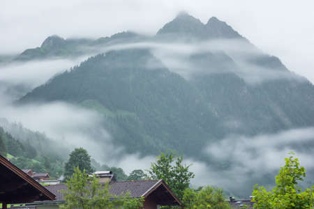 Low morning clouds and haze floating in the valleys of the mountains around Fusch an der Grossglocknerstrasse