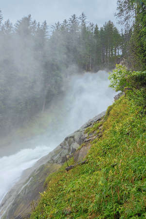Spray floating through the air at the Krimml Waterfalls seen from the Regen Kanzel on the path to the upper part of the waterfall 版權商用圖片