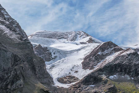 Close up of the Grosser Barenkopf with fresh snow, seen from the Mooserboden reservoir