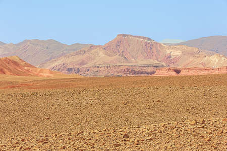 Stone desert with red colored eroded mountains near the Dades Gorges