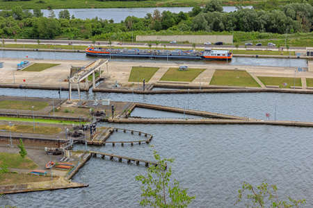 Barge entering the Locks of Ternaaien on the Albert Canal next to the Dutch border Stock fotó