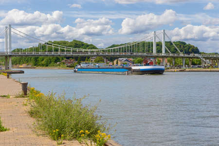 Barge passing under the bridge of Kanne on the Albert Canal Stock fotó