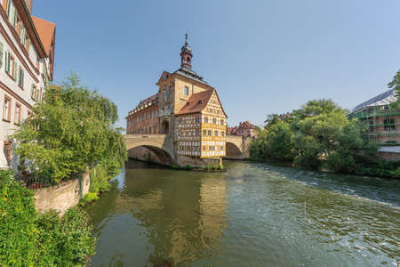 The Old Town Hall with the Upper Bridge built over the Regnitz River Banco de Imagens