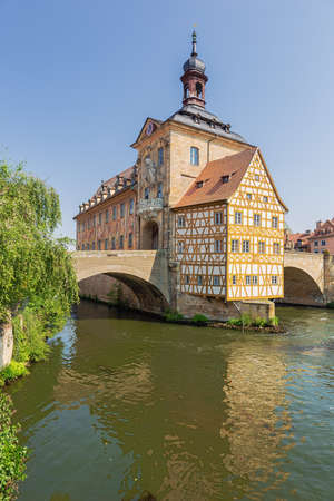 Close up of the Old Town Hall with the Upper Bridge built over the Regnitz River
