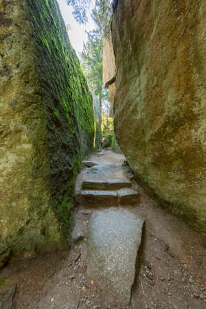 Looking into a fairylike narrow passage in the Luisenburg rock labyrinth