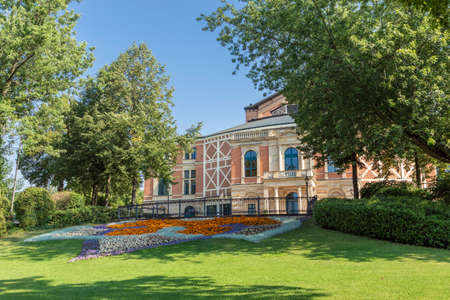 The Bayreuth Festspielhaus peeking through the trees, in front of the theater