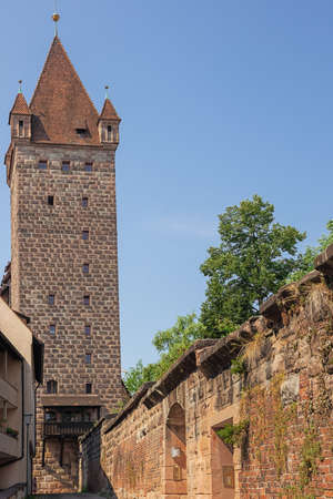 A watchtower of the Nuremberg Castle in the middle of a residential area