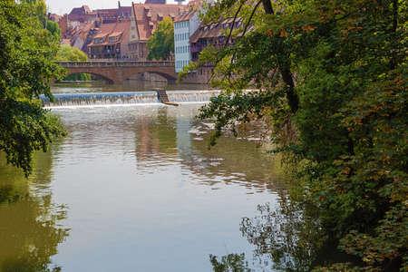 The Pegnitz river entering the old town near the Haller Gate Bridge Banco de Imagens