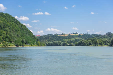 The confluence of the Danube and the Inn seen from the tip of the old city of Passau Banco de Imagens