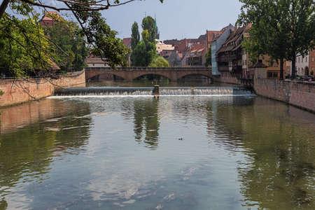 Walking over the Pegnitz River in Nuremberg near the Haller Gate Bridge