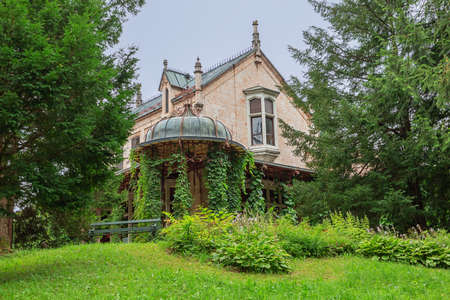 Editorial: BAD ISCHL, UPPER AUSTRIA, AUSTRIA, August 14, 2020 - The Marble Castle emerging from behind the trees in the park of the imperial villa