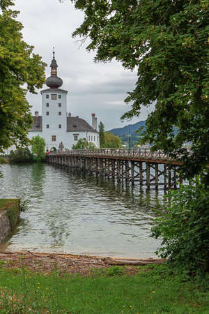 The castle of Orth and the access bridge in the Traunsee