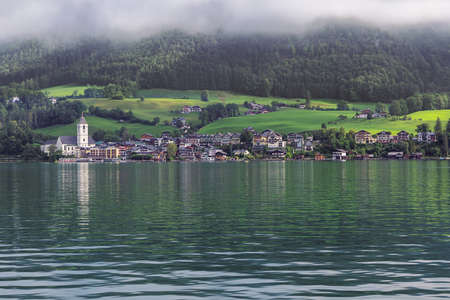 Editorial: ST. WOLFGANG, UPPER AUSTRIA, AUSTRIA, August 16, 2020 - Early morning clouds lifting over St. Wolfgang, seen from the jetty in Gschwendt Editoriali