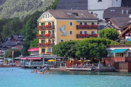 Editorial: ST. WOLFGANG, UPPER AUSTRIA, AUSTRIA, August 16, 2020 - View of St. Wolfgang with the White Horse Inn, seen from the ferry to Gschwendt