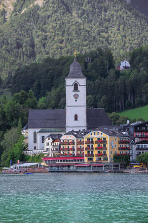Editorial: ST. WOLFGANG, UPPER AUSTRIA, AUSTRIA, August 16, 2020 - Distant view of St. Wolfgang with the White Horse Inn, seen from the ferry to Gschwendt