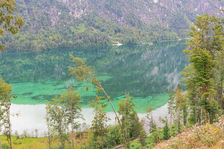 Turquoise water and reflections in the Almsee, on the hike to the Ameisstein