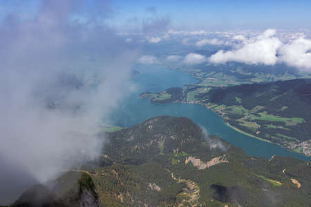 Looking through the clouds at the Mondsee, seen from the Schafberg