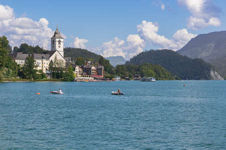 Editorial: ST. WOLFGANG, UPPER AUSTRIA, AUSTRIA, August 16, 2020 - View of St. Wolfgang with Lake Wolfgang, seen from the jetty in front of the railway station of the Schafbergbahn