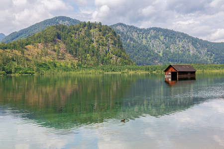 Close up of a flooded barn in the Almsee, seen from the southern shore of the lake