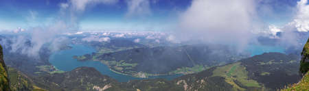 Panorama of the Mondsee and the Attersee, seen through the clouds from the Schafberg