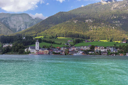 Editorial: ST. WOLFGANG, UPPER AUSTRIA, AUSTRIA, August 16, 2020 - St. Wolfgang in the late afternoon sun with Lake Wolfgang, seen from the middle of Lake Wolfgang Editoriali