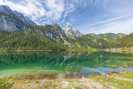 Overview of the Vorderer Gosausee with the Donnerkogel, seen from the shore of the lake