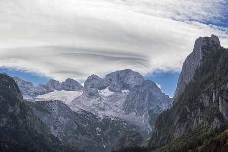 Lenticular clouds above Gosau glacier, seen from the Vorderer Gosausee