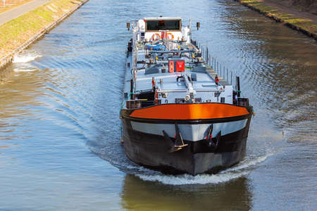 Barge navigating on the canal Herentals-Bocholt in the vicinity of Lommel 스톡 콘텐츠