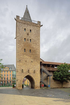 Standing in front of the Johannistor the only remaining preserved city gate of the city of Jena Редакционное