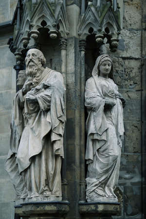milion: Medieval statues at the facade of St. Thomas Church in Leipzig, Germany