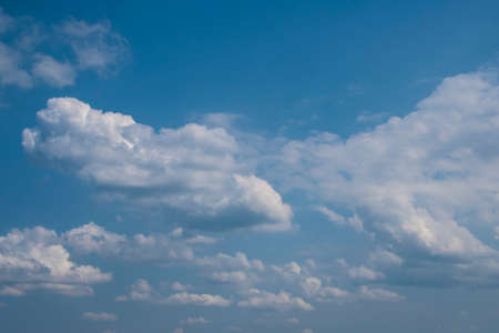 White clouds on the blue sky. Abstract background with clouds on blue sky. In the clear sky high floating clouds. Stock fotó