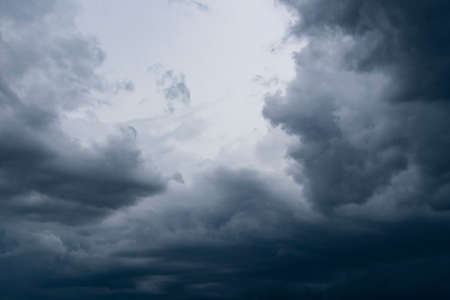 Dark thunder clouds on the blue sky. Abstract background with clouds on blue sky. Stock fotó