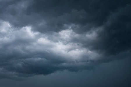 Dark thunder clouds on the blue sky. Abstract background with clouds on blue sky. Stock fotó - 128995344
