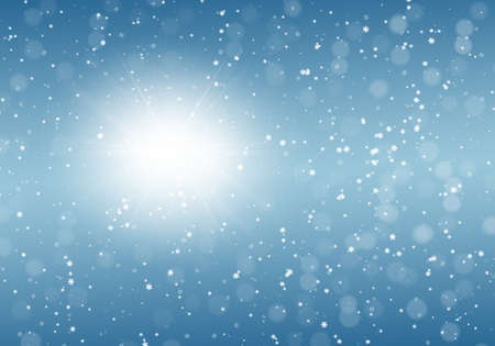 Snowflakes and fallen defocused snowflakes on blue winter background Stock Photo