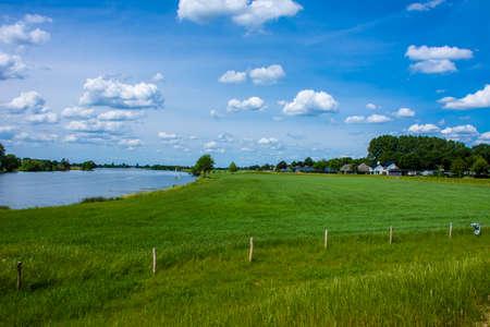 Dutch river landscape. Maas River in the Dutch village of Aijen in the Dutch municipality of Bergen, Limburg, Eastern Netherlands