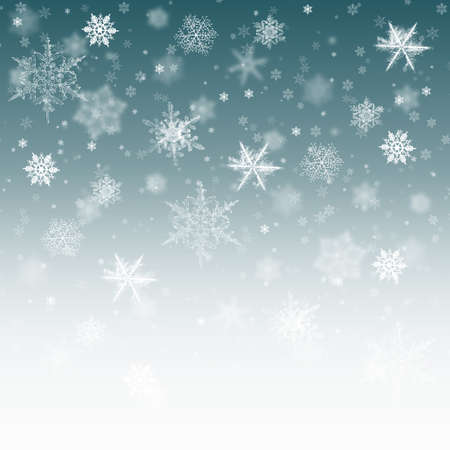 Snow background blue. Christmas snowfall with defocused flakes. Winter concept with falling snow. Holiday texture and white elements.