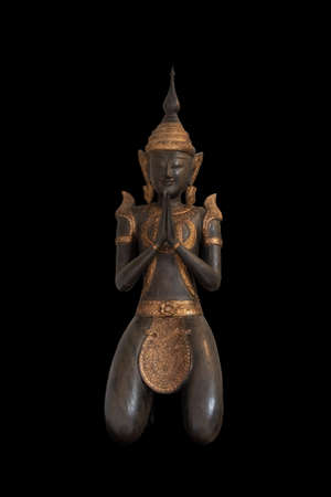 Bronze Buddha statue isolated on black background. Sign for peace and wisdom