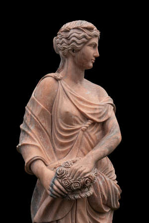 Clay statue of an ancient Greek goddess isolated on black background